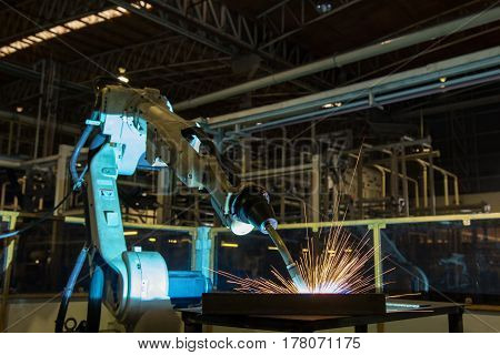 Robot welding assembly automotive part in factory