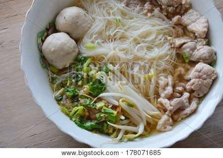 vermicelli with pork ball in soup on bowl