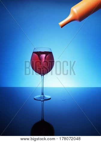 Storm In A Glass Of Red Wine On A Blue Background