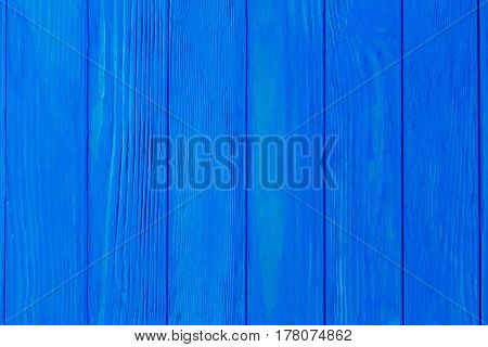 Blue wooden planks background free space. Painted natural material backdrop.