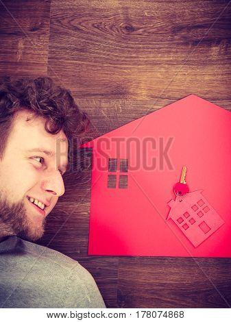 Man Lying With House Symbols.