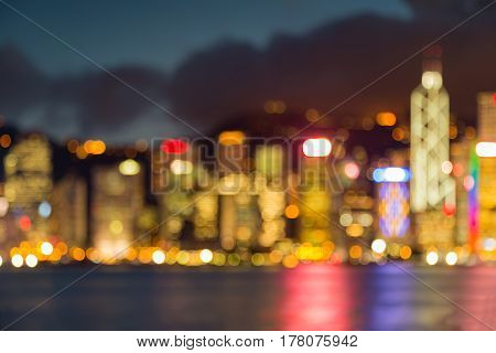 Night blurred bokeh Hong Kong city building water front abstract background