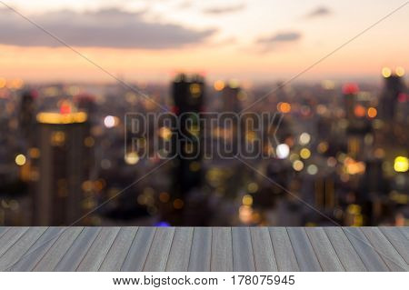 Opening wooden floor blurred bokeh light city downtonw skyline abstract background