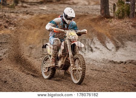 Motocross Driver Accelerating The Motorbike On The Race Track