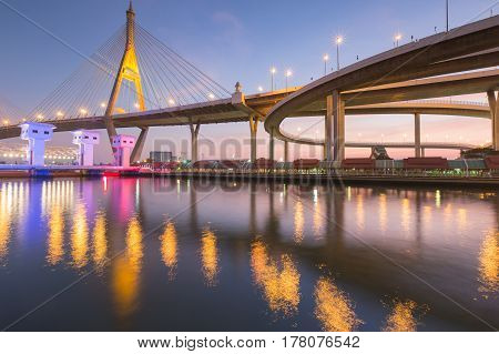 Suspension bridge connect to highway over white watergate and light reflecition Bangkok Thailand landmark