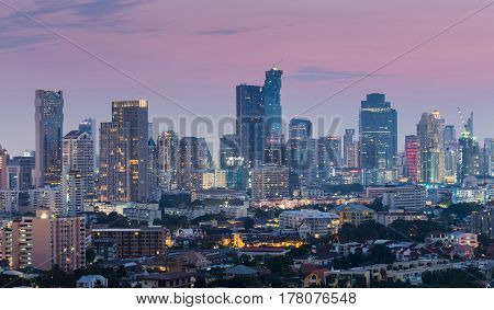 City office building light night view with beauty twilight sky background