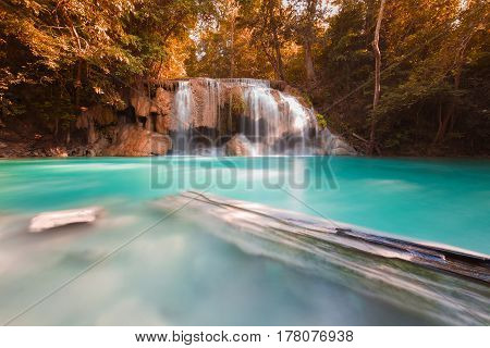 Sun beam over deep forest natural waterfall natual landscape background