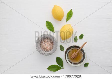 Homemade Skincare Concept, Bath Salt, Lemon, Honey Dipper And Mint On White Wooden Background From T