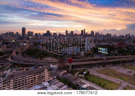 Aerial view city highway interchanged with business downtown with beautiful sky background Bangkok Thailand