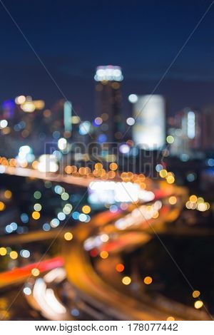 Aerial view blurred bokeh city and highway interchanged light abstract background