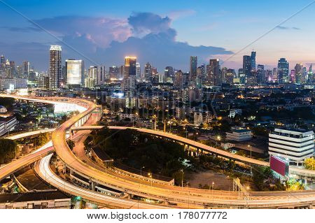 Twilight city office downtown and highway intersection Bangkok Thailand