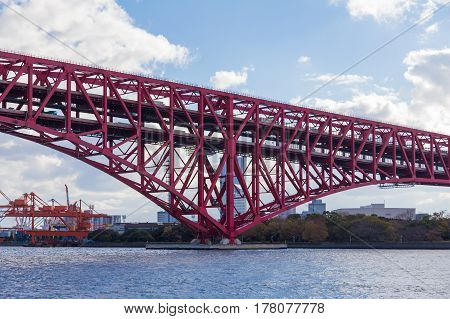 Minato Bridge cross over Osaka sea port Japan red steel bridge