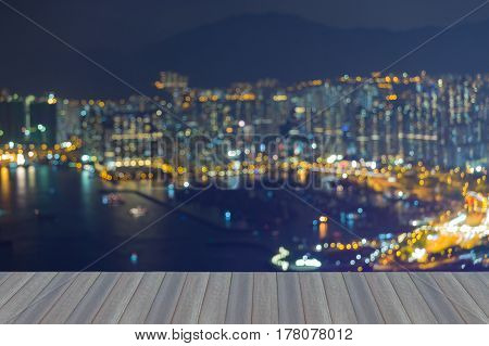 Opening wooden floor Aearial view blurred bokeh light Hong Kong city downtown abstract background