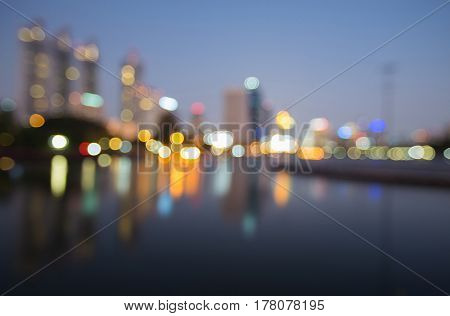 Reflection blurred bokeh light office building abstract background