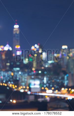 Night city office tower blurred bokeh light abstract background