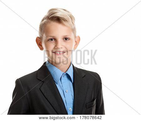 Portrait of young confident smiling boy in school uniform