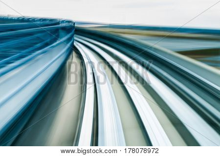 Motion blurred moving train in Kobe Japan abstract background