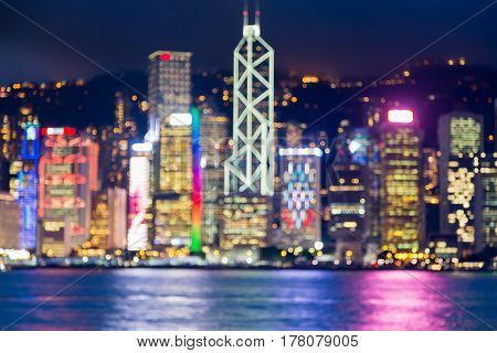 Night blurred bokeh Hong Kong city sea fornt at twilight abstract background