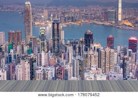 Opening wooden floor Hong Kong city central business downtown aerial view at twilight