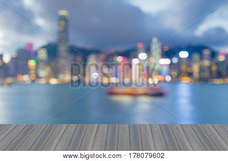 Opening wooden floor Twilight blurred bokeh lights Hong Kong city night view abstract background