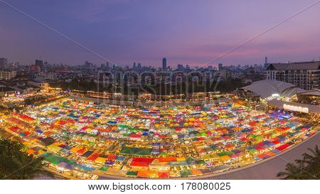 Aerial view city night weekend market roof top with city downtown at twilight background Bangkok Thailand
