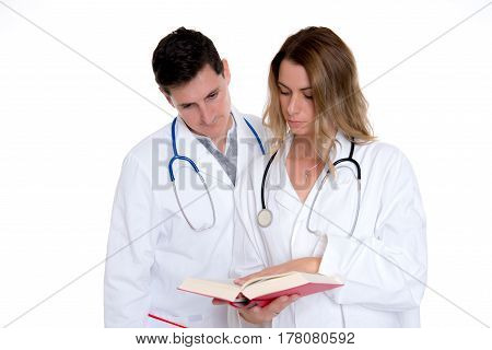 Young Friendly Medical Team With Book In Lab Coat