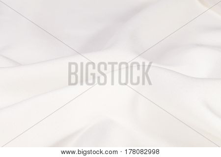 Silk background texture of white shiny fabric close up