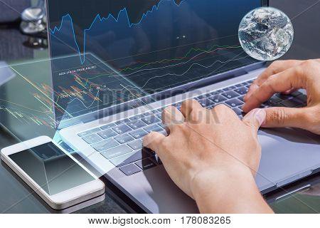 business man use computer check stock market data credit earth by NASA