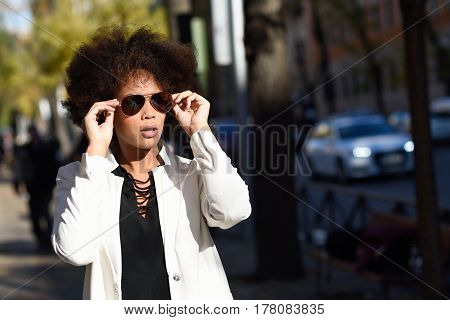 Young Black Woman With Afro Hairstyle With Aviator Sunglasses
