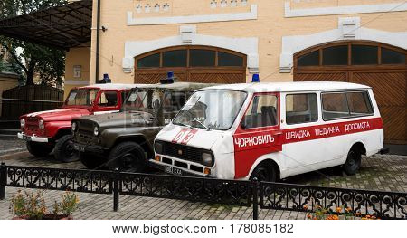 KIEV, UKRAINE - SEP 21, 2013: Museum of the History of Chernobyl - ambulance, fire service and the police who participated in the liquidation of the disaster.
