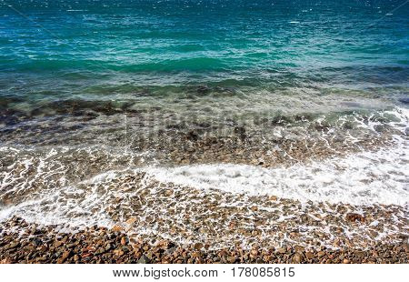 ocean coastline with calm waves and turquoise water