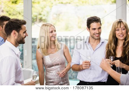 Group of friends having cocktail at a party