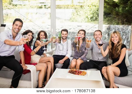 Portrait of friends having cocktail drinks at party