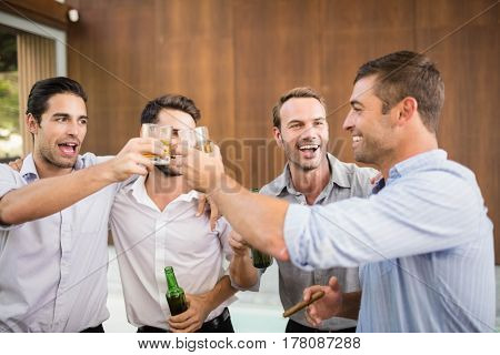 Group of young men having drinks at the party