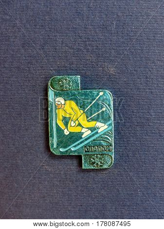 USSR - CIRCA 1980: Badge with a picture of mountain skier and the inscription