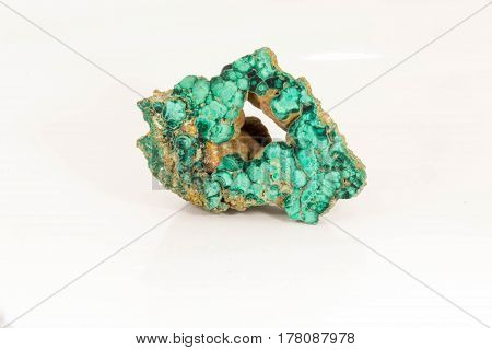 Beautiful semiprecious stone green malachite on a white background