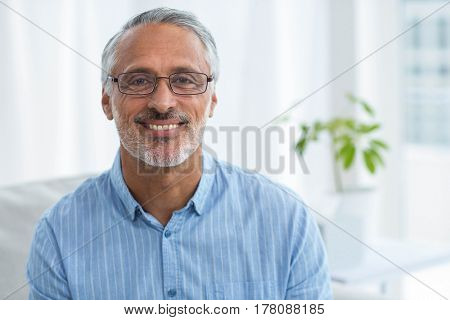 Portrait of doctor smiling at home