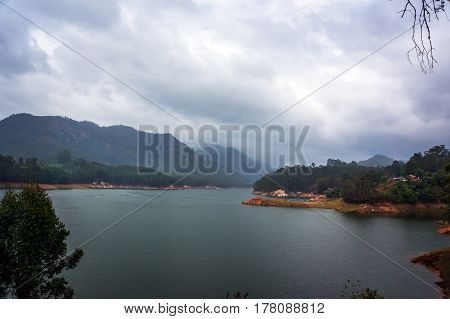 Beautiful Landscape With Mountain Lake Amid High Mountains With Tea Plantations And Cloud Sky.