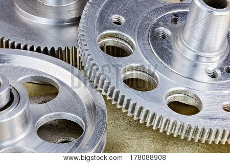 Metal Used Gear Cogwheels And Pulley On Industrial Background