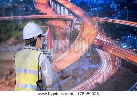 Double exposure construction engineer checking construction site for new expressway Infrastructure for transportation project.Photo concept fot enginerring work.