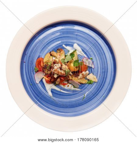 Chicken salad on blue plate isolated over white background