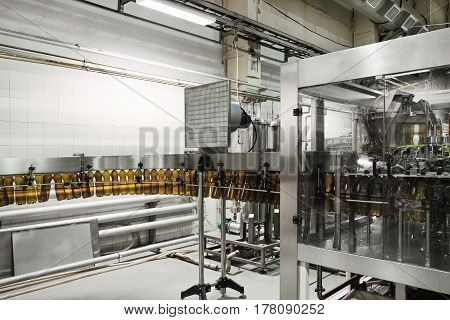 Cooling conveyor for plastic bottles. Before filling machine. Brewery.