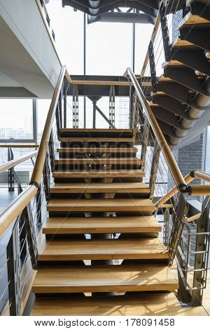 empty office wooden stairs in modern building