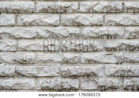 brick wall stone textured gray facade background