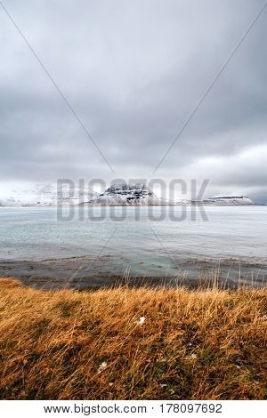Snowy madow with snow covered mountain in the background, Iceland