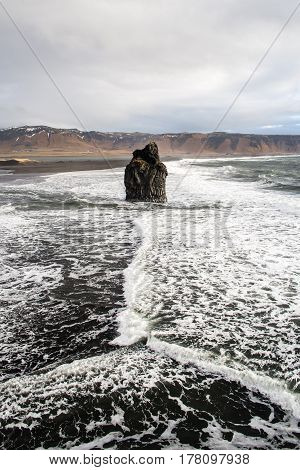 Iceland Vik south coast black volcanic beach shore with waves and mountains