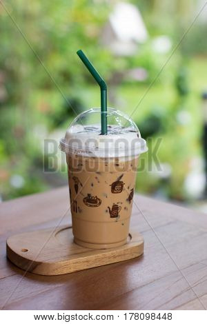 iced mocha with straw in plastic cup