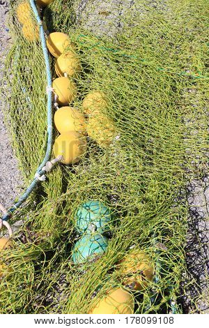Many fishing nets stretched in a port