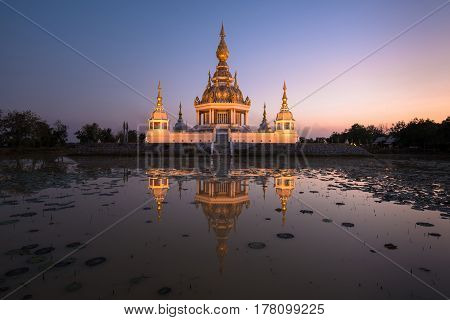 Beautiful buddhist pagoda with dusk sky in Thailand