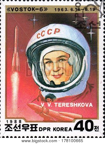 UKRAINE - CIRCA 2017: A stamp printed in DPR KOREA shows first cosmonaut woman V. V. Tereshkova circa 1988